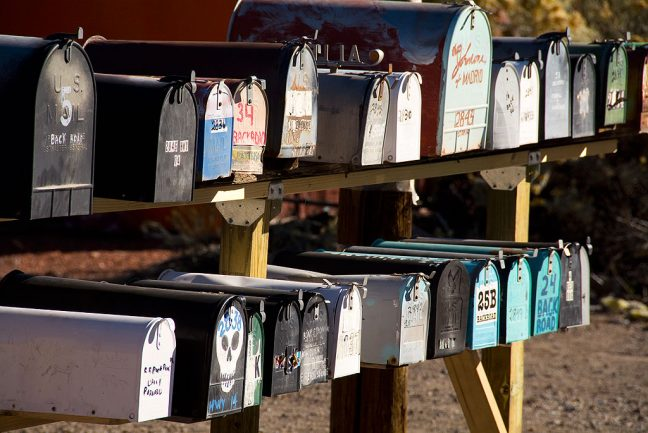 Since there is only one road in Madrid, New Mexico, the mailboxes are clustered together along the highway at several locations, including this one on the south end of town.