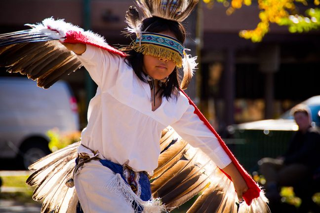 Native American dancers perform in The Plaza at Santa Fe.