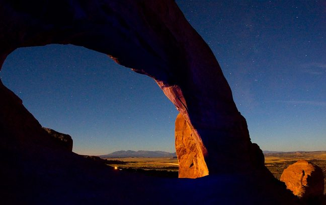 This 30-second exposure shows Wilson Arch illuminated by the rising moon and a little bit of light from my blue flashlight.