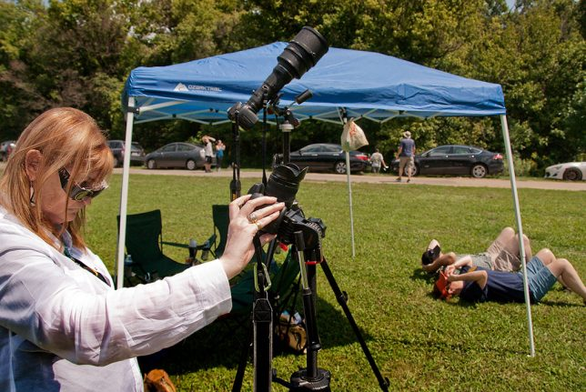 Abby readies her camera just seconds before the totality, while Nicole and Tracey lay on the grass with their eclipse glasses on. You can see my 400mm plus teleconverter at the ready.