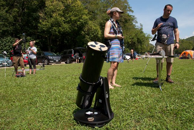 Eclipse watchers set up their telescopes and viewing devices.
