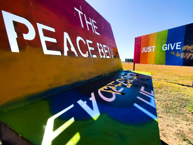 "Several benches are installed at the Texas ""peace park,"" like this one labeled ""The Peace Bench."""