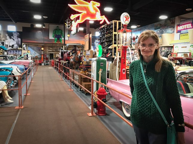 Abby smiles as she tours the free car museum at Russell's Travel Stop in far eastern New Mexico. Abby loves fast cars, and knows everything about them.