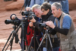 Photographers at Arches National Park in Utah in April 2011; their postures and facial expressions are ruggedly serious. Their cameras are all obediently trained on the iconic Delicate Arch. The light at the time, however, was the dullest and least inspirational I have ever seen at this location, and despite being there for half an hour, I made almost no images.