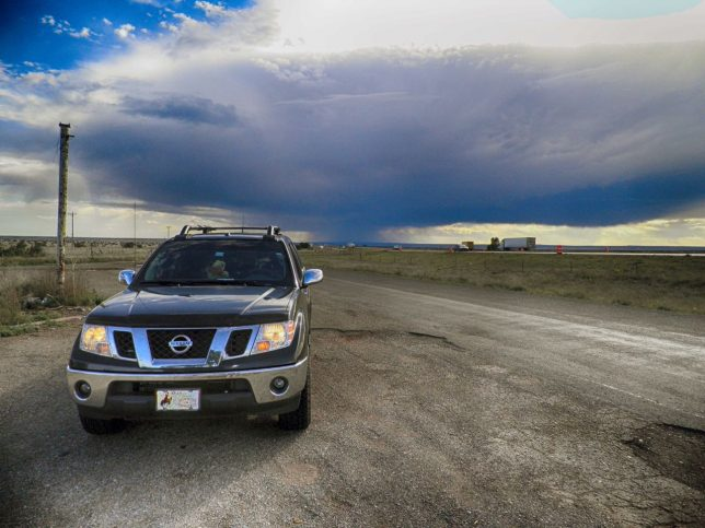 A thunderstorm looms over our Nissan Frontier at a turnout on Interstate 40 in New Mexico in 2016. I shot this with my Olympus FE-5020 because it was in my shirt pocket.