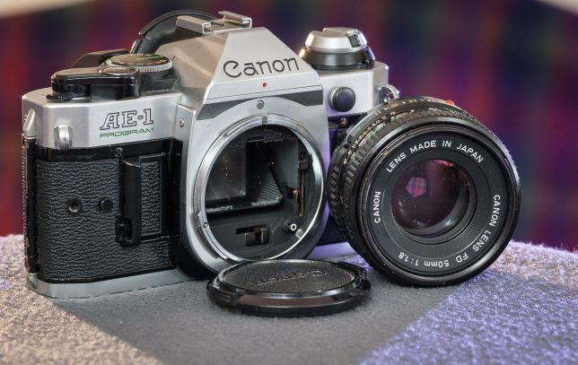 The Canon AE-1 Program is shown with its lens removed.