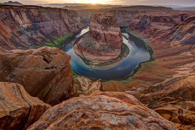 Horseshoe Bend of the Colorado is shown in this April 2015 fisheye view, with the curved line straightened out using Adobe Photoshop.