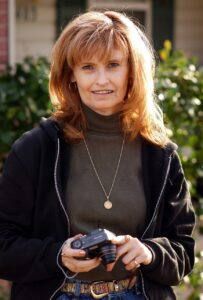 Abby holds her Nikon Coolpix 885 as she and I have a photo session in the late winter of 2004.
