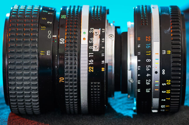 """The Nikkor 35-70mm f/3.3-4.5 and the Nikkor 50mm f/1.8 sit back-to-back. They are among the smallest lenses in this class. The 50mm is known as a """"pancake"""" lens because it's so flat."""