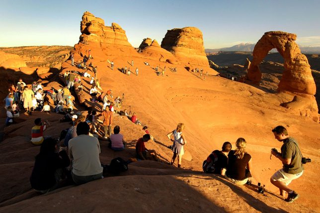 I photographed this passel of visitors at Delicate Arch in October 2005.
