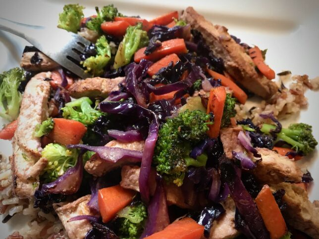 This is the end result of my go-to stir-fry: Gardein Meatless Chik'n strips, broccoli, carrots, and red cabbage, stir-fried until brown and tender, served over a bed of rice/quinoa mix. I have been eating this dish for 30 years, and I never get tired of it.