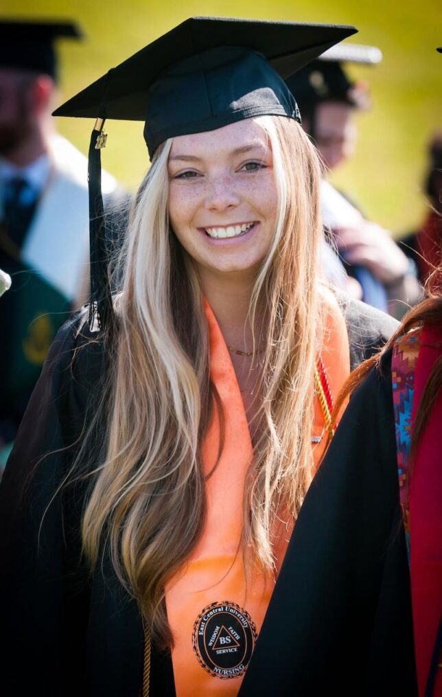 A long-time friend of mine, Kaitlyn Redman, spotted me as I covered ECU graduation Saturday, and waved me over, so I made this image of her. I have known her since she was just a kid, and am friends with her whole family.