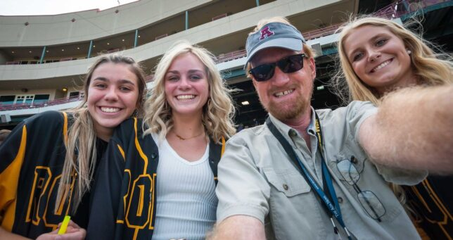 As the Roff baseball game progressed, the mood became very jovial, so I snuck in with some of my young fan friends for a selfie.