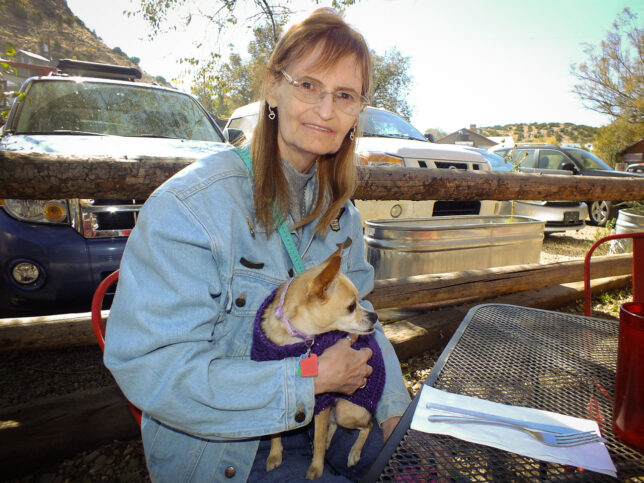 Abby and her Chihuahua Summer enjoy lunch in the sunshine at The Hollar in Madrid, New Mexico in 2019.