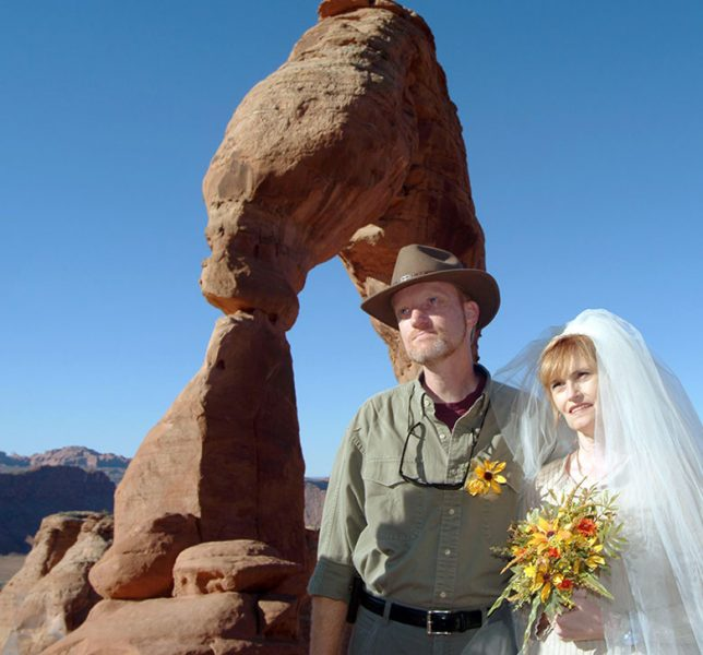 Richard and Abby exchange wedding vows at Utah's iconic Delicate Arch in October 2004.