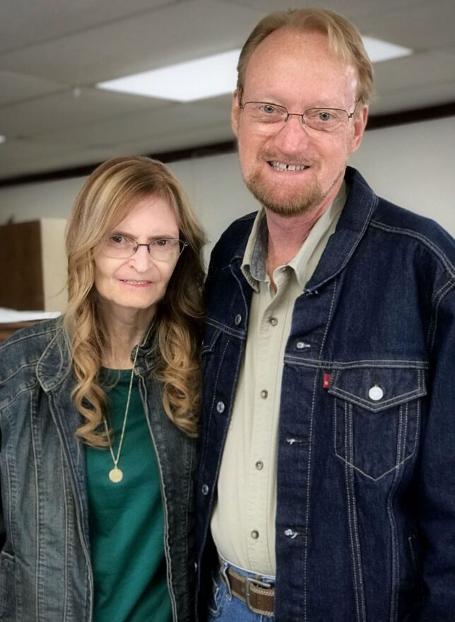 Abby and Richard pose for a photo after getting their hair cut in April 2021.