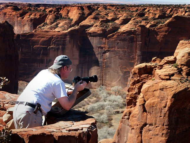 Michael leans out to make a picture from one of the overlooks at Canyon de Chelley National Monument near Chinlé, Arizona.