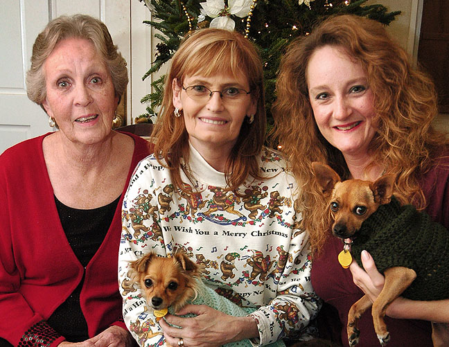 Mom, Abby and Nicole pose with our dogs Sierra and Max on Christmas Eve 2006.