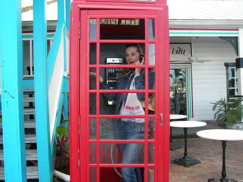 Nicole poses in a phone box in the Bahamas.