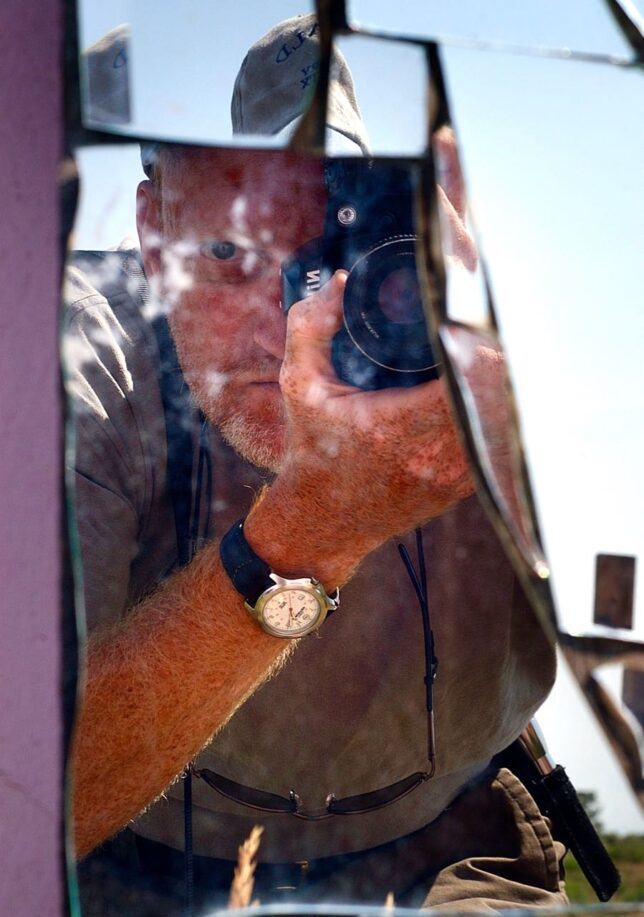 I photographed myself in a reflection from a broken mirrored cross art installation at the Old Pink Schoolhouse.