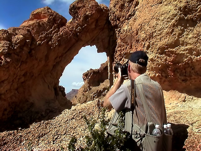 Your host photographs an unnamed conglomerate natural arch in The Chimneys section of Big Bend.