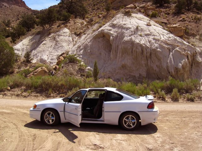 The author's Pontiac Grand Am, with a new heater hose, sits on the road at Cottonwood Canyon.