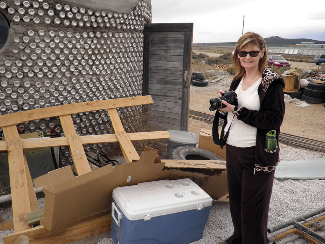 Abby smiles as she photographs the EarthShip House northwest of Taos, New Mexico.