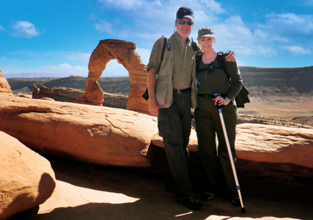 Abby and I pose for a photo at Delicate Arch where we got married in 2004.