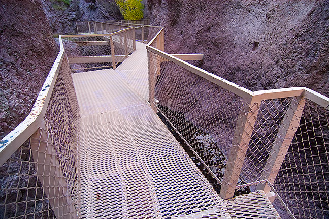 "The heart of ""The Catwalk"" is a trail that follows Whitewater Creek through narrows. The Catwalk itself was originally constructed by silver miners."