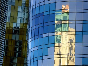 Buildings and sky shine on the reflective panels of The Hamon, a hotel at City Center in Las Vegas. The quarter-billion dollar structure was never occupied, and because of construction deficits is slated to be demolished.