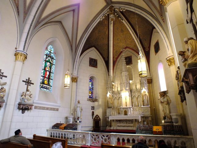 This is a view showing the sanctuary of Loretto Chapel.