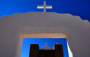 Crosses pick up high country sunlight at Taos Pueblo.