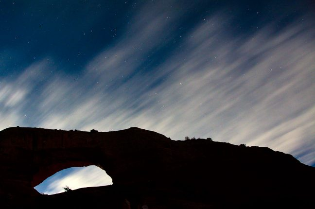 This 30-second exposure shows stars and clouds silhouetted against Wilson Arch.