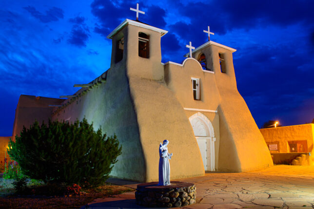 This is a single frame, lightly-edited version of what I was trying to accomplish photographing the church in Rancho de Taos. The greenish light coming from behind the bush on the right was from my LED light stick.
