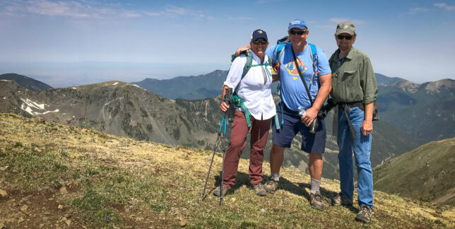 Kathy Schoettle, Scott AndersEn and I pose on the saddle between Wheeler Peak and Mount Walter, both 13,000+ feet peaks. By the time you've made the saddle, you've made the peaks.