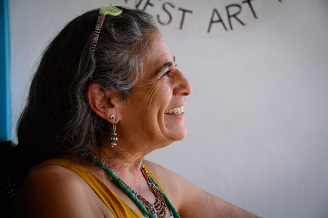 Mayé Torres smiles for passersby at her gallery on The Plaza in Taos.