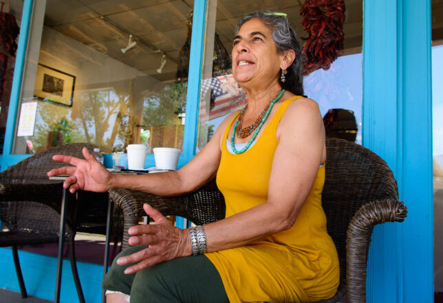 Mayé Torres gestures as she greets a visitor to her gallery on The Plaza in Taos.