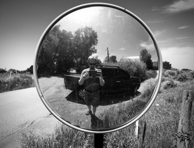 I found this traffic mirror - placed to fill a blind spot in the curvy road - on Arroyo-Hondo Road.