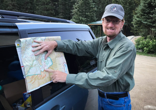 Your humble host points to his trail map of the route to Wheeler Peak, the high point of New Mexico at 13,167 feet.