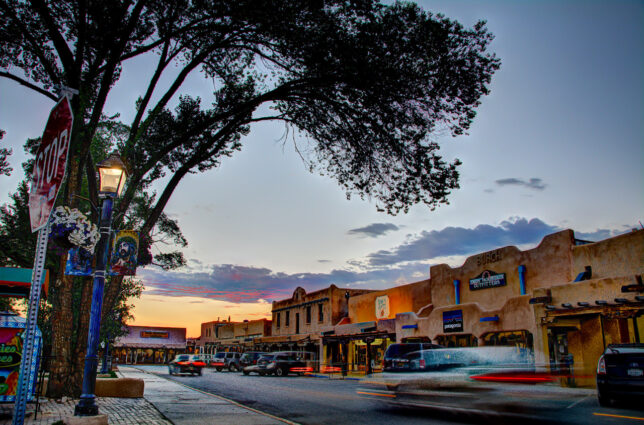 The Plaza in Taos begins to take on mixed light at dusk.