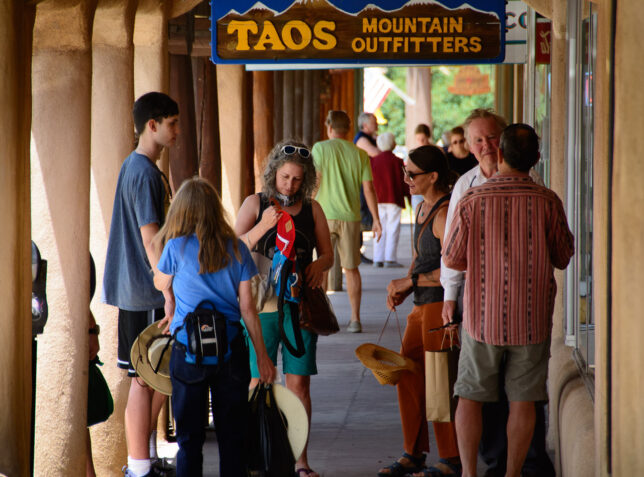 Visitors look over the various shops and galleries on The Plaza in Taos. Abby and I have made many similar images in nearby Santa Fe.