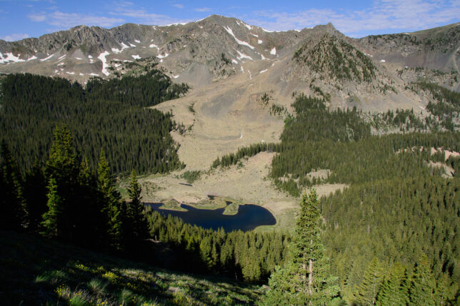 Looking west from near the top of the Wheeler Peak trail shows peaks on the other side of the valley, and, well below, Williams Lake.